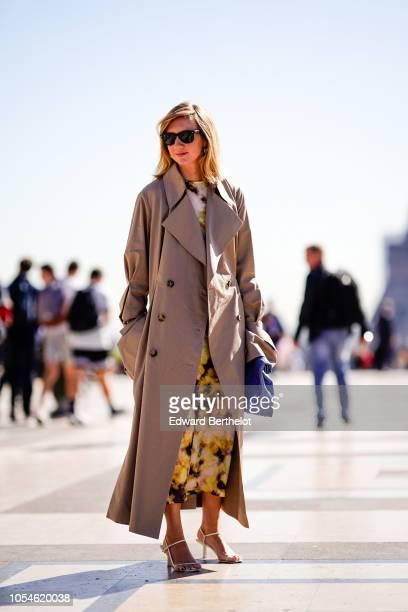 Lisa Aiken wears sunglasses a trench coat outside Ann Demeulemeester during Paris Fashion Week Womenswear Spring/Summer 2019 on September 27 2018 in...