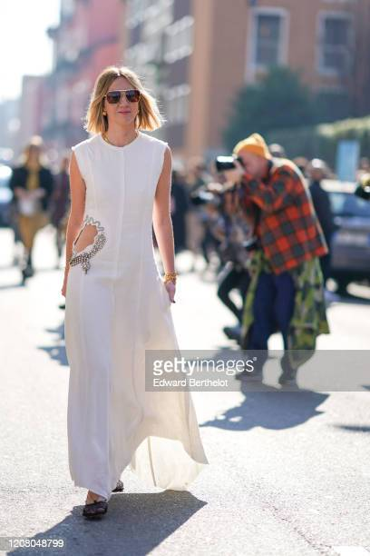 Lisa Aiken wears sunglasses a white sleeveless dress outside MSGM during Milan Fashion Week Fall/Winter 20202021 on February 22 2020 in Milan Italy