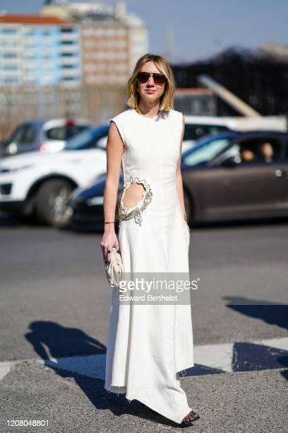 Lisa Aiken wears sunglasses, a white sleeveless dress, outside MSGM, during Milan Fashion Week Fall/Winter 2020-2021 on February 22, 2020 in Milan,...