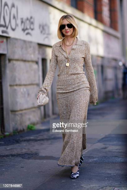 Lisa Aiken wears sunglasses a wool dress a golden necklace outside Marni during Milan Fashion Week Fall/Winter 20202021 on February 21 2020 in Milan...