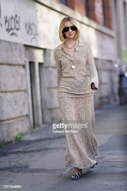 Lisa Aiken wears sunglasses, a wool dress, a golden necklace, outside Marni, during Milan Fashion Week Fall/Winter 2020-2021 on February 21, 2020 in...