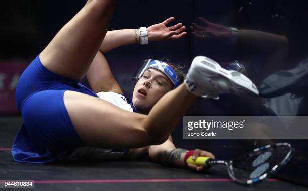 Lisa Aitken crashes into the wall during her women's double match with team mate Alison Thomson of Scotland against SarahJane Perry and Laura Massaro...