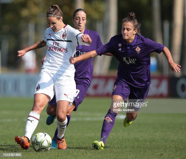 Lisa Alborghetti of AC Milan is challenged by Alice Tortelli of Fiorentina Women's FC during the Serie A match between AC Milan Women and Fiorentina...