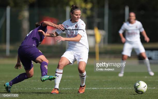 Lisa Alborghetti of AC Milan is challenged by Lyliana Ivanova Kostova of Fiorentina Women's FC during the Serie A match between AC Milan Women and...
