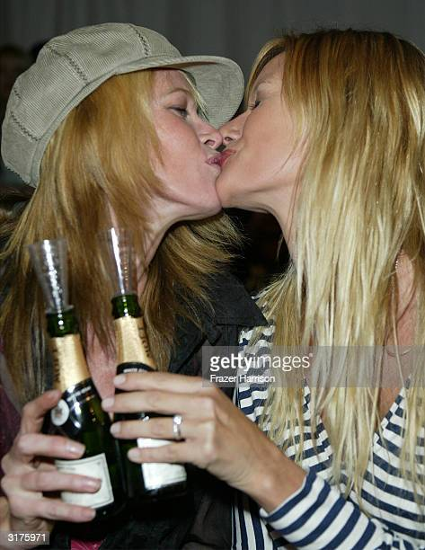 Lisa Amore and Susan Holmes attend the Custo Barcelona show at MercedesBenz Fashion Week held at Smashbox Studios March 30 2004 in Culver City...
