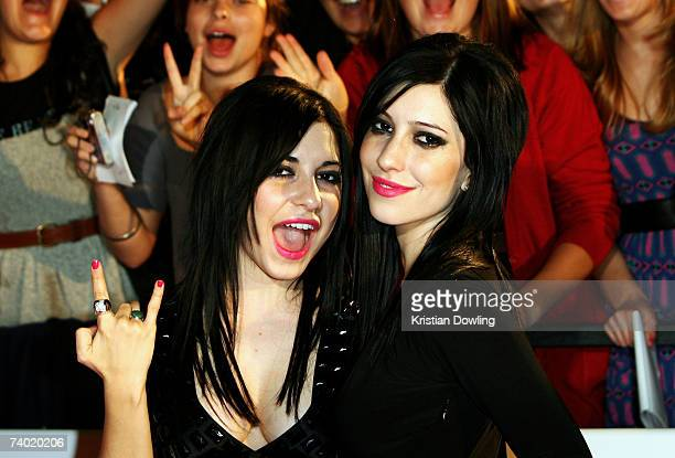 Lisa and Jessica Origliasso of The Veronicas pose on the red carpet at the third annual MTV Australia Video Music Awards 2007 at Acer Arena on April...