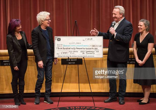Lisa and Kevin Cronin of REO Speedwagon presents a check to Thousand Oaks Mayor Rob McCoy and Vanessa Bechtel from the benefit concerts' proceeds to...