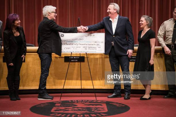 Lisa and Kevin Cronin of REO Speedwagon presents a check to Thousand Oaks Mayor Rob McCoy and Vanessa Bechtel to be given to the Ventura County...