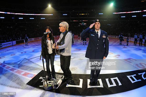 Lisa and Kevin Cronin sing the National Anthem prior to the game between the Los Angeles Kings and the Washington Capitals at Staples Center on...