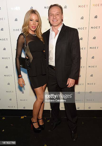 Lisa and Leonard Hochstein attends Moet Rose Lounge Miami Hosted By 2 Chainz at Delano South Beach on November 7 2013 in Miami Beach Florida