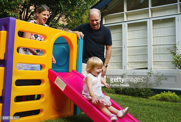 Lisa and Mark Warlters with their 2 year old daughter Poppy in the backyard of their home which they bought last year at auction in a bid to have...