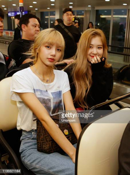 Lisa and Rose of South Korean girl group Blackpink arrive at an airport on March 2 2019 in Taipei Taiwan of China