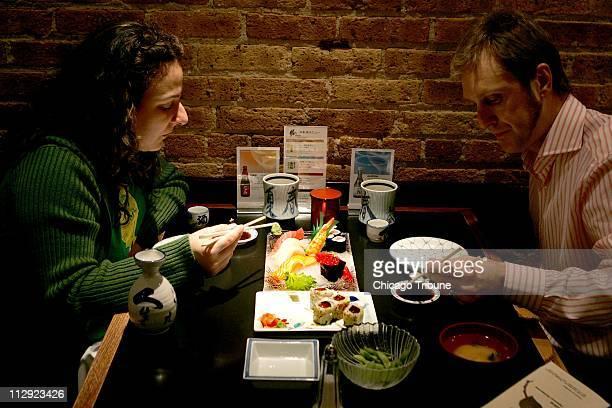 Lisa and Shane Winn enjoy sushi at Katsu restaurant in Chicago, Illinois, Wednesday, April 5, 2006. Restaurant owners Haruko Imamura and her husband,...