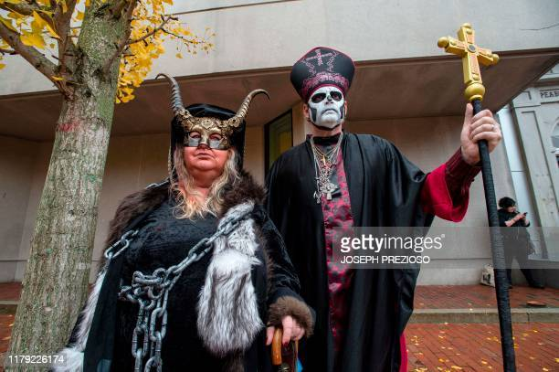 Lisa and William DeLuca pose as evil members of the dark church during Halloween on October 31 2019 in Salem Massachusetts Salem is a mecca for...