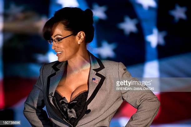 Lisa Ann an adult film star and Sarah Palin tribute artist gets up after speaking to members of the press at Thee DollHouse gentleman's club on...