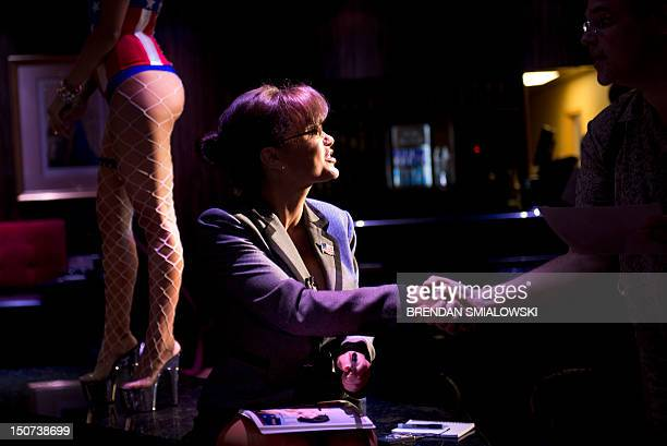 Lisa Ann an adult film star and Sarah Palin tribute artist speaks to members of the press at Thee DollHouse gentleman's club on August 25 2012 in...