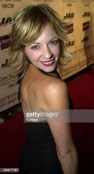 Lisa Arturo of American Pie 2 poses for members of the media while arriving at an Emmy party hosted by Brentwood Magazine
