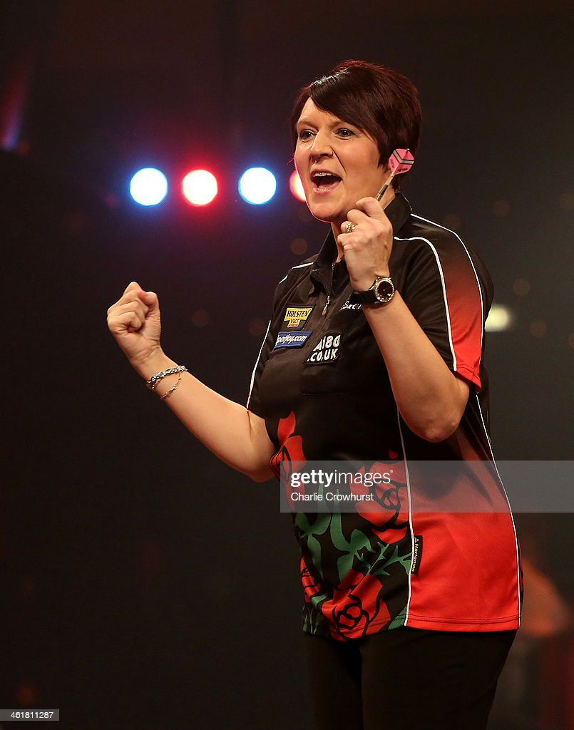 Lisa Ashton of England celebrates after winning the final against Deta Hedman of England during the BDO Lakeside World Professional Darts Championships at Lakeside Complex on January 11, 2014 in Frimley, England.
