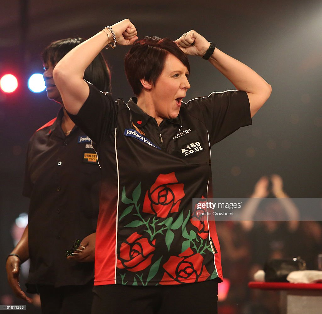 Lisa Ashton of England celebrates winning the final against Deta Hedman of England during the BDO Lakeside World Professional Darts Championships at Lakeside Complex on January 11, 2014 in Frimley, England.