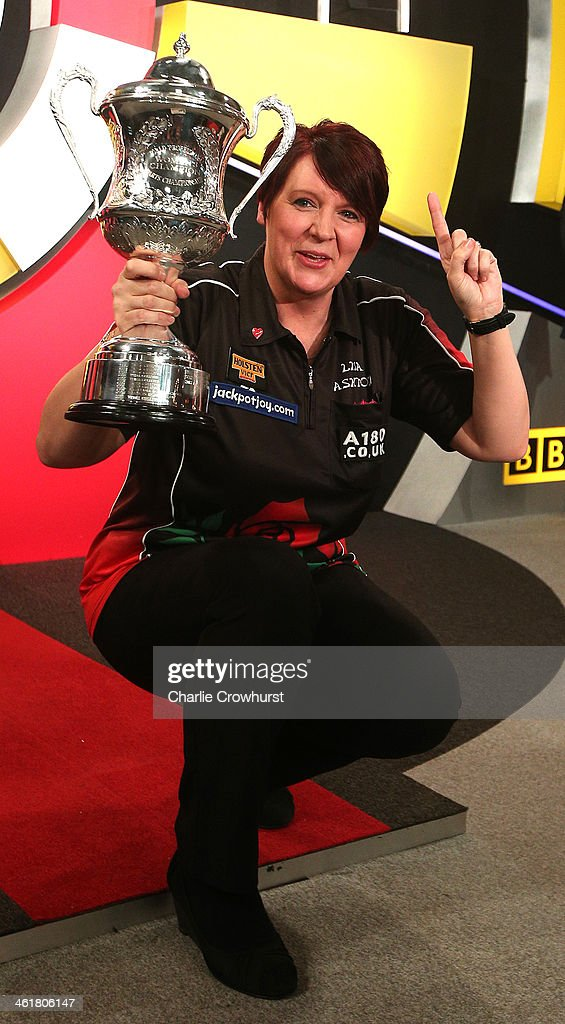 Lisa Ashton of England celebrates with the trophy after winning the final against Deta Hedman of England during the BDO Lakeside World Professional Darts Championships at Lakeside Complex on January 11, 2014 in Frimley, England.