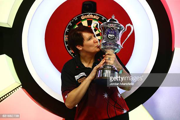 Lisa Ashton of England poses with the trophy after victory in her Women's Final match against Corrine Hammond of Australia on Day Eight of the BDO...