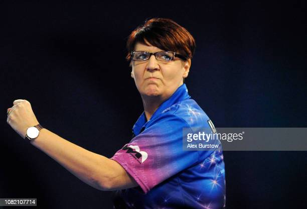 Lisa Ashton of England reacts during her match against Jan Dekker of the Netherlands during Day One of the 2019 William Hill World Darts Championship...