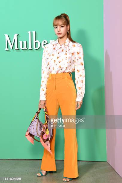 Lisa attends the photocall for Mulberry at 'KMCA Seoul ' on June 09 2018 in Seoul South Korea