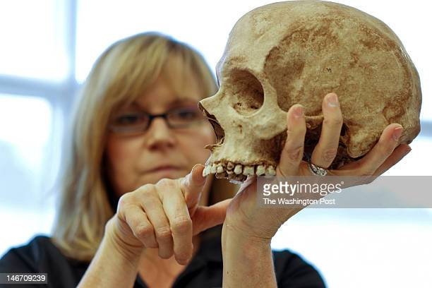 Lisa Bailey a forensic artist with the FBI demonstrates how she sculpts a face onto a scull based on the scull features and discuss's the...