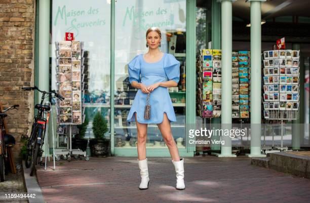 Lisa Banholzer is seen wearing blue dress Ellery earrings Louis Vuitton Paco Rabbane bag boots Fabienne Chapot during Mercedes Benz Fashion Week...