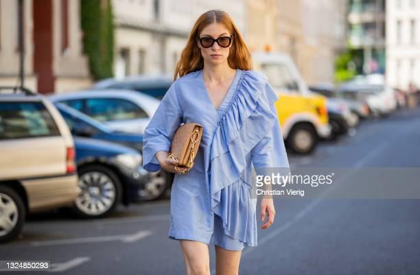 Lisa Banholzer is seen wearing blue dress Stine Goya, bag Louis Vuitton, shoes Dior on June 21, 2021 in Berlin, Germany.