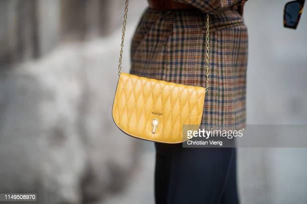 Lisa Banholzer is seen wearing cycle pants Aeance, brown plaid blazer vintage, yellow bag Bally, slipper Gucci on May 15, 2019 in Berlin, Germany.