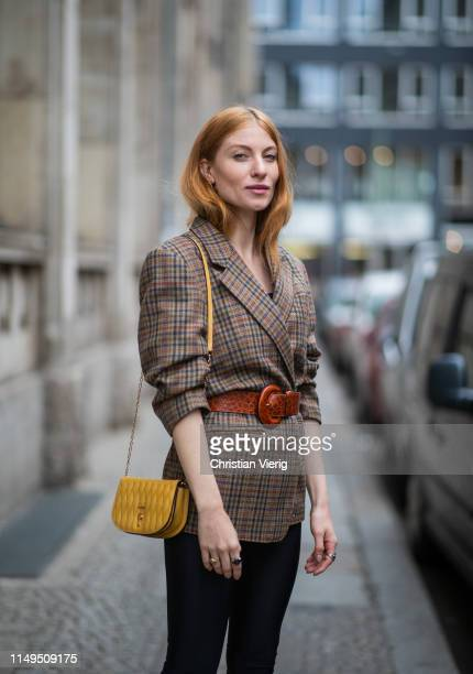 Lisa Banholzer is seen wearing cycle pants Aeance brown plaid blazer vintage yellow bag Bally on May 15 2019 in Berlin Germany