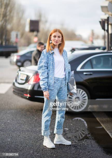 Lisa Banholzer is seen wearing denim jacket and pants silver clutch outside Lacoste during Paris Fashion Week Womenswear Fall/Winter 2019/2020 on...