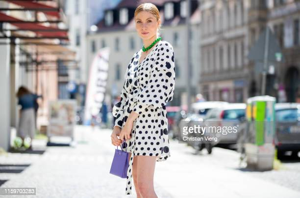 Lisa Banholzer is seen wearing print with dots print Mother of Pearl purple Medea bag Mercedes Benz Fashion Week Berlin on July 02 2019 in Berlin...