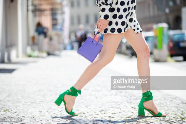 Lisa Banholzer is seen wearing print with dots print Mother of Pearl, shoes Fabienne Chapot and purple Medea bag during Mercedes Benz Fashion Week...
