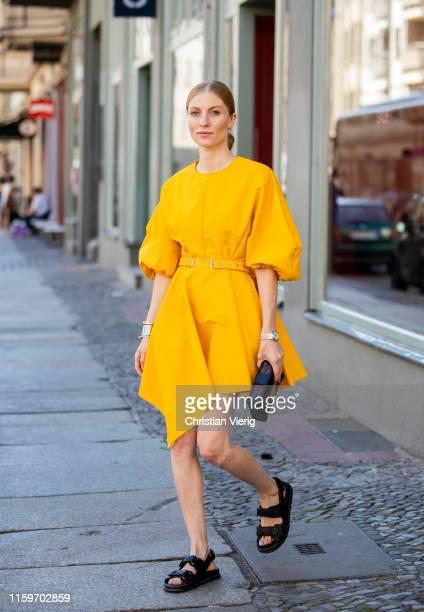 Lisa Banholzer is seen wearing yellow dress Marques' Almeida, Louis Vuitton bag, sandals Chanel, IWC watch during Mercedes Benz Fashion Week Berlin...