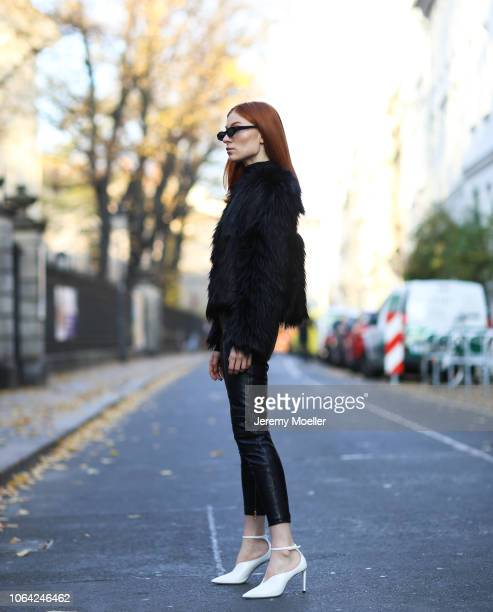 Lisa Banholzer wearing a Mango trousers sweater from Designers Remix Liu Jo coat Prada bag and Mango shoes on October 28 2018 in Berlin
