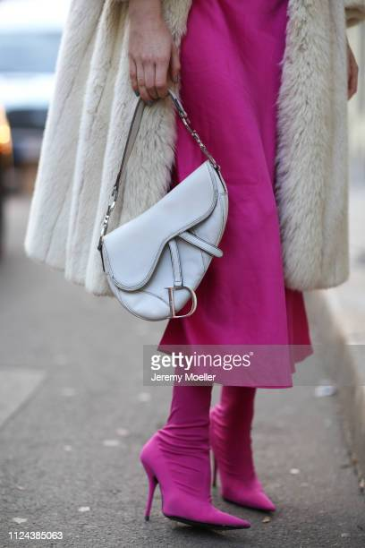 Lisa Banholzer wearing Balenciaga shoes Anine Bing dress Dior bag and Vintage coat on January 23 2019 in Berlin Germany