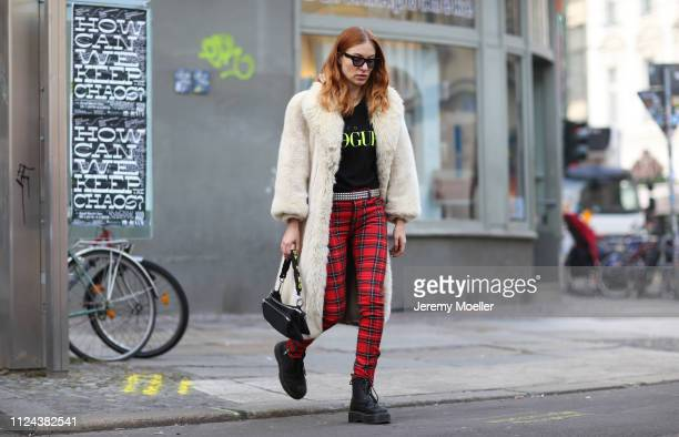Lisa Banholzer wearing Dr. Martens Shoes, Topshop pants, Vogue shirt, Yun glasses and a Diesel bag on January 23, 2019 in Berlin, Germany.