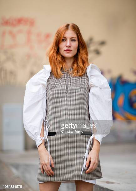 Lisa Banholzer wearing dress with white wide ruffled sleeves is seen outside Lala Berlin lunch presenting SS19 collection on November 22 2018 in...