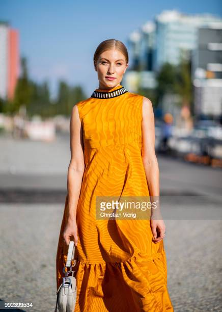 Lisa Banholzer wearing mustard dress seen outside Dawid Tomaszewski during the Berlin Fashion Week July 2018 on July 5 2018 in Berlin Germany