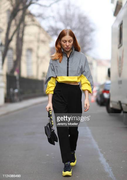 Lisa Banholzer wearing RAF Simons shoes Lacoste pants Topshop jacket and Diesel bag on January 23 2019 in Berlin Germany
