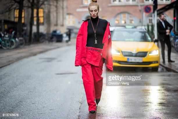 Lisa Banholzer wearing red Gosha Rubchinskiy x Carhartt pants and jacket black Woolford turtleneck Gucci keychain is seen during the Copenhagen...