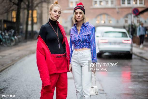Lisa Banholzer wearing red Gosha Rubchinskiy x Carhartt pants and jacket black Woolford turtleneck Gucci keychain and Lisa Hahnbueck wearing striped...