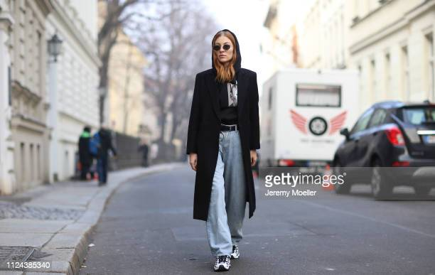 Lisa Banholzer wearing Weekday pants, Diesel hoodie and Puma shoes on January 23, 2019 in Berlin, Germany.