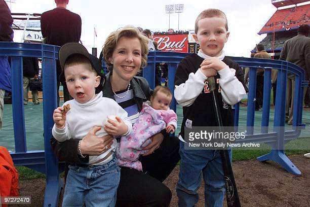 Lisa Beamer arrives at Shea Stadium with sons Drew and David and 2monthold daughter Morgan for the New York Mets' season opener against the...