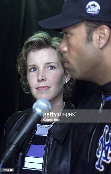 Lisa Beamer whose husband Todd Beamer was killed on flight 93 over PA listens to New York Mets'' Roberto Alamar speak after receiving a check from...