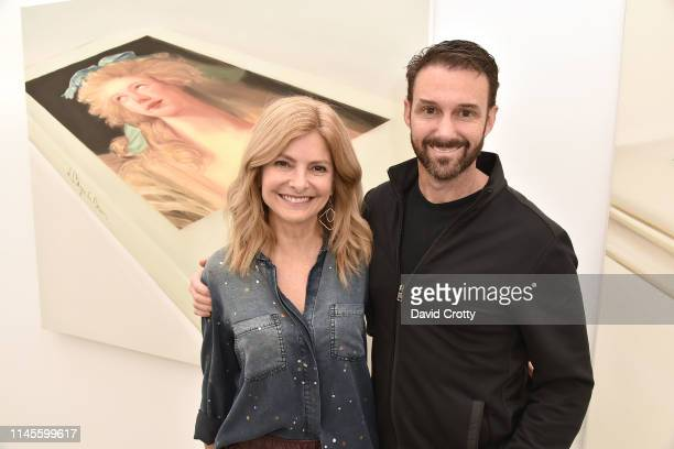 Lisa Bloom and Braden Pollock attend the opening of Robert Russell's Book Paintings exhibition at Anat Ebgi Gallery on April 27 2019 in Los Angeles...