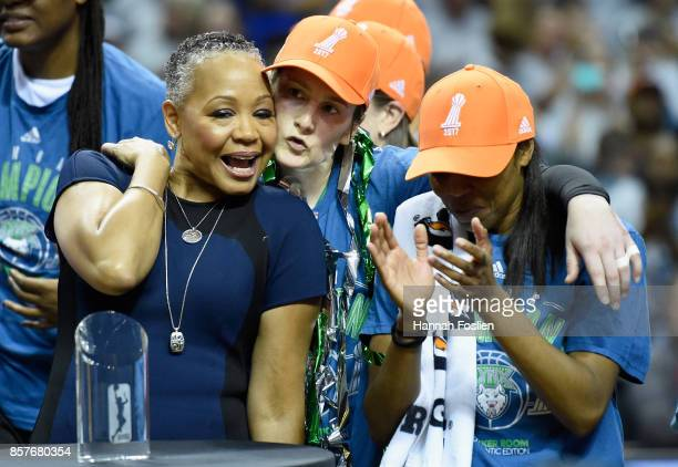 Lisa Borders President of the WNBA embraces Lindsay Whalen and Renee Montgomery of the Minnesota Lynx after the Lynx defeated the against the Los...