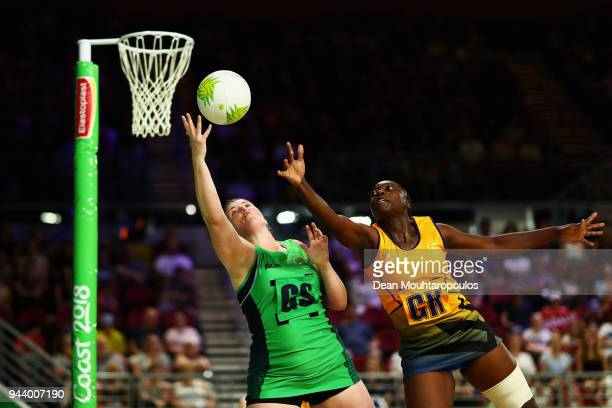 Lisa Bowman of Northern Ireland battles for the ball with Shonette AzoreBruce of Barbados during Netball on day six of the Gold Coast 2018...
